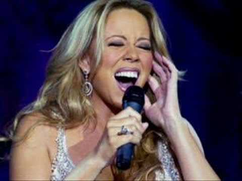 Mariah Carey belting on stage singing her heart out