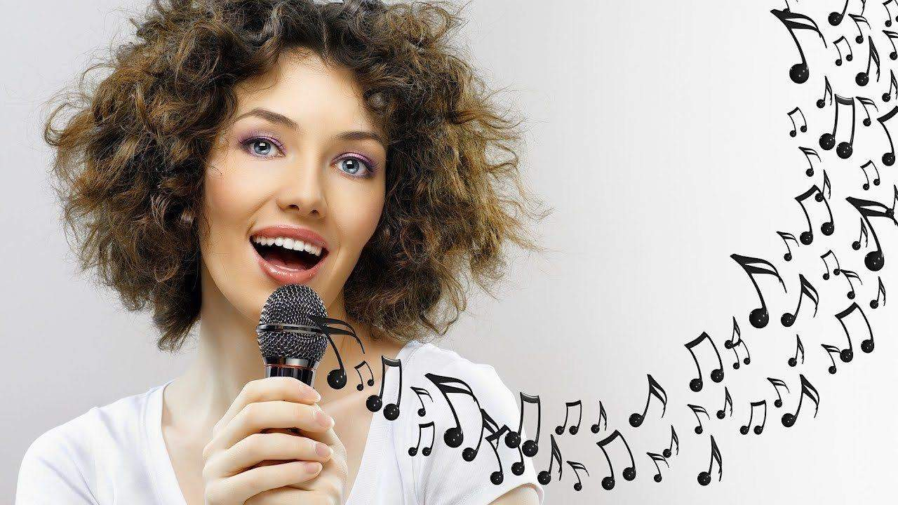 woman doing singing exercises with notes comming out of the microphone